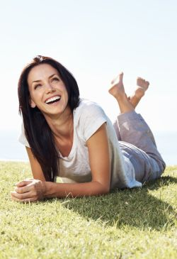 Smiling woman thinking of the gratitude she feels