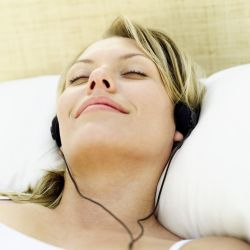 Woman relaxing using music to overcome anxiety