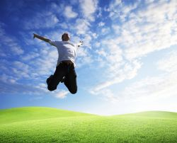 Man jumping for joy found a key to happiness