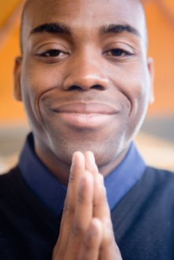 Man with praying hands offering daily gratitude