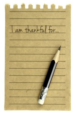 Paper and pencil for writing a gratitude list