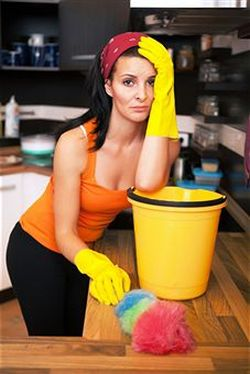 Woman doing housework in pain.